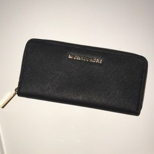Michael Kors zip around black wallet.